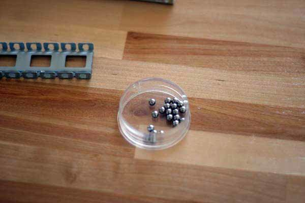 Ball-bearings in container.